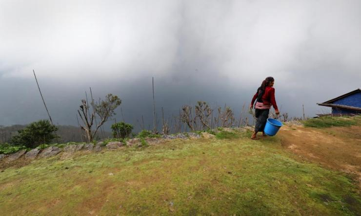 woman walking on a terrace in Sikles, Nepal