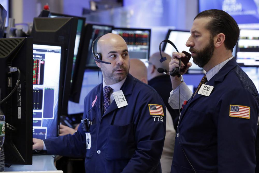 Fred DeMarco, Greg MulliganTraders Fred DeMarco, left, and Greg Mulligan confer on the floor of the New York Stock Exchange, Monday, Feb. 8, 2016. Stocks are opening broadly lower on Wall Street, putting the market on track for its second sizable loss in a row. (AP Photo/Richard Drew)