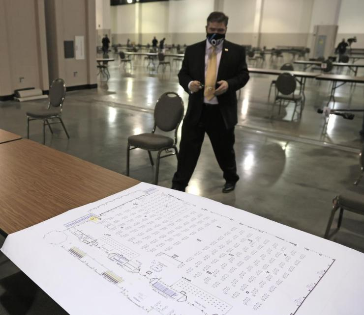 A table chart sits before Milwaukee County Clerk George L. Christenson during preparations for the recount.