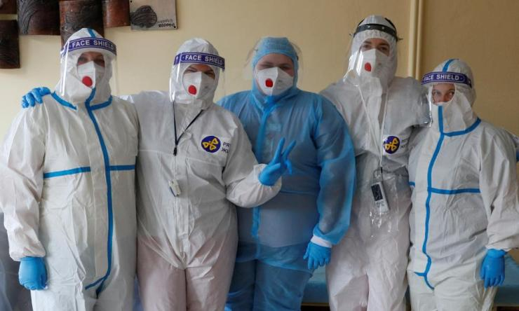 Medical specialists pose for a picture in a hospital for patients infected with the coronavirus disease in KyivDoctors and medical specialists wearing personal protective equipment pose for a picture in a hospital for patients infected with coronavirus, Kyiv, Ukraine 25 November 2020.