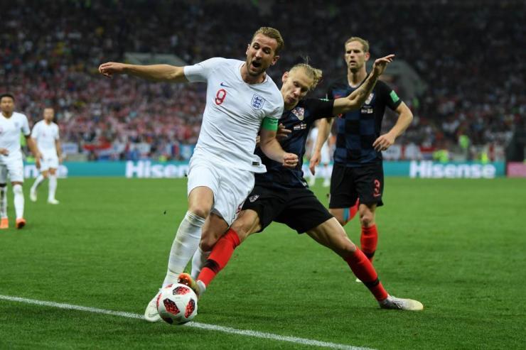 Domagoj Vida of Croatia and Harry Kane of England tussle.