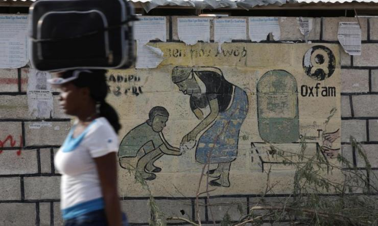 An Oxfam sign in Corail, a camp for displaced people of the 2010 earthquake, on the outskirts of Port-au-Prince, Haiti.
