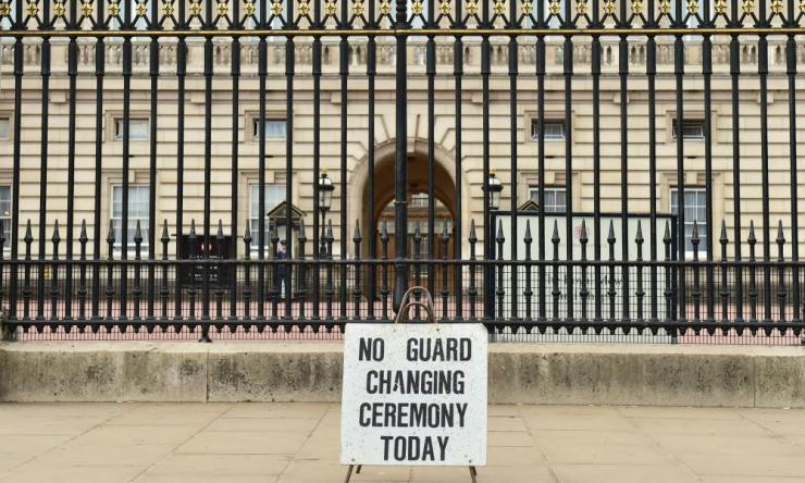 A sign outside Buckingham Palace, London, after the Changing the Guard ceremony at the palace was cancelled