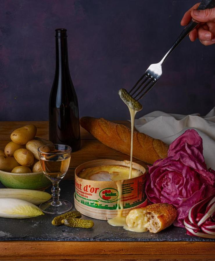 Baked vacherin with potatoes and cornichons, by Olia Hercules. Food styling: Henrietta Clancy.