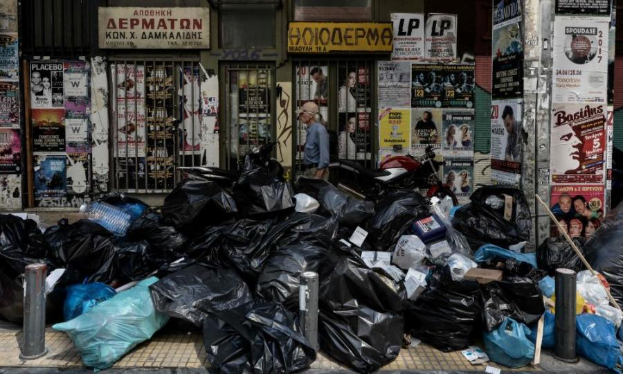 Rubbish accumulates in Athens as municipal workers protest against austerity.