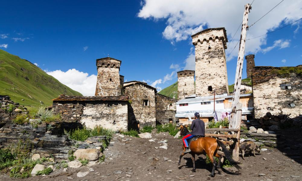 Man on horseback at Chazhashi (Ushguli), the highest permanently inhabited village in Europe. Svaneti, Georgia.