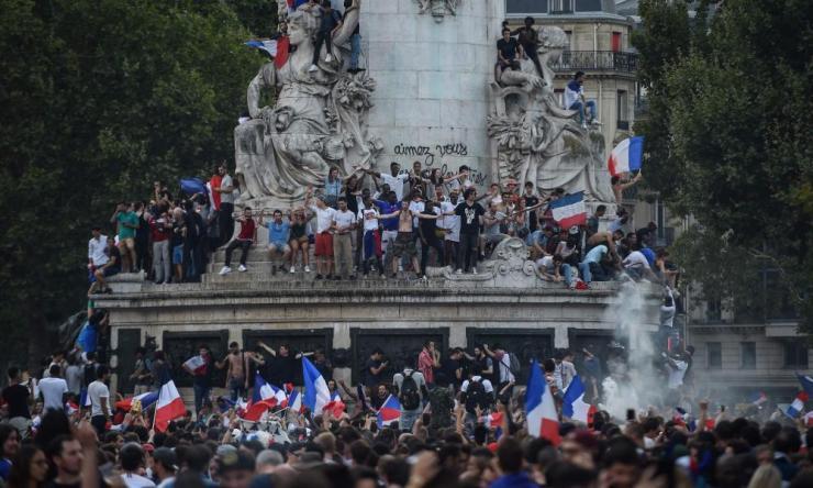 Celebrations in the fountain on the Place de la République in Paris.