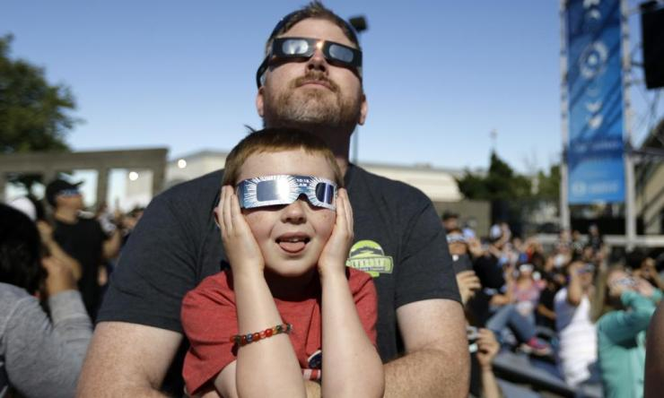 BlanchetteDan Blanchette and his son, Sam, 6, watch the final phases of a total solar eclipse in Salem, Oregon.
