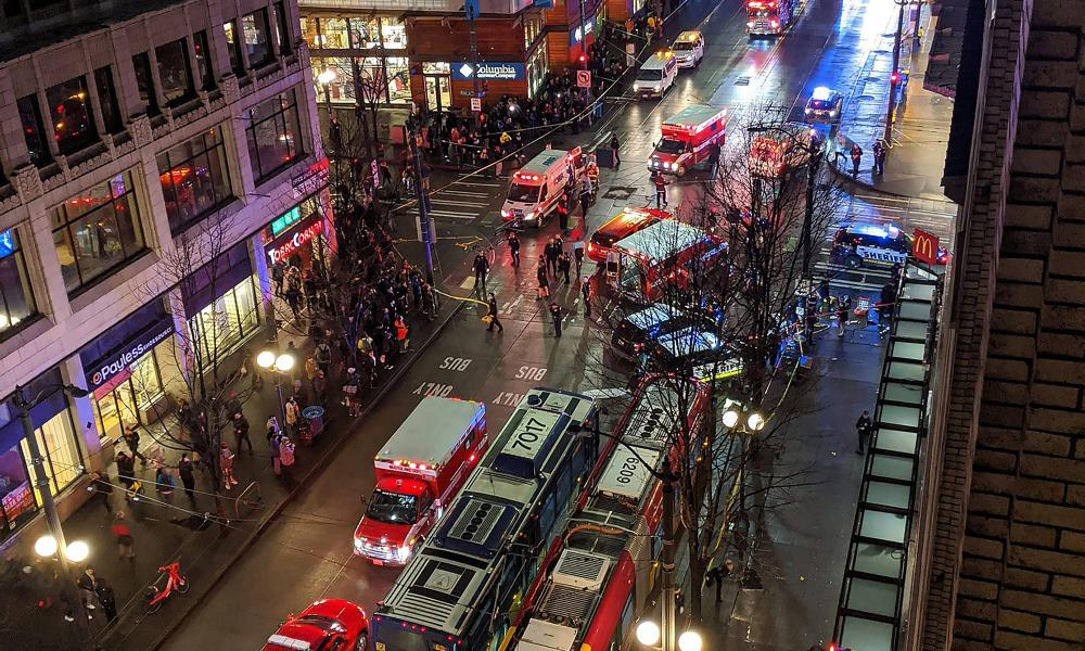 This handout image taken by Nikesh Parekh and posted on Twitter shows police activity at the scene of a shooting in downtown Seattle