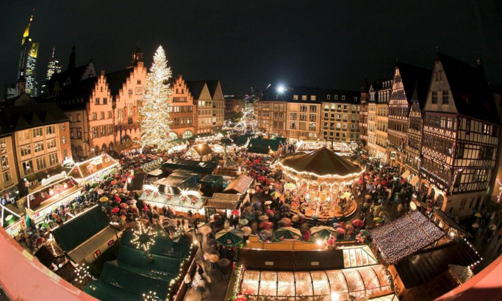 Illuminated booths are seen during the opening of the Christmas market in Frankfurt Main, Germany.