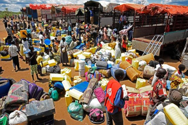 South Sudanese refugees wait to board a truck at Imvepi reception centre in north Uganda ahead of being relocated