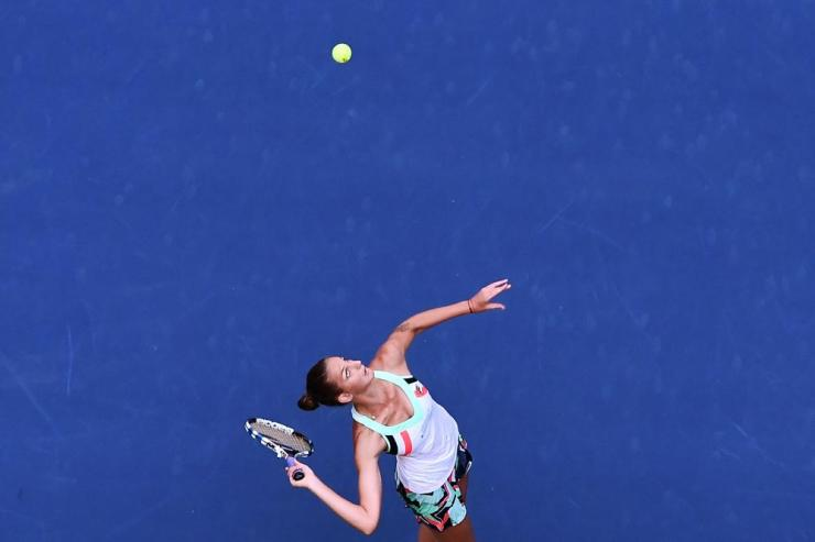 Karolina Pliskova serves the ball to Jennifer Brady.