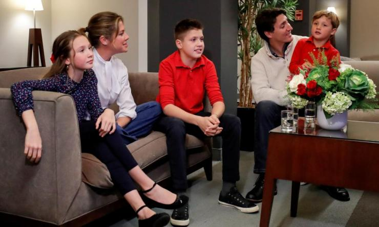 Prime Minister Justin Trudeau and his wife Sophie Gregoire Trudeau, sons Xavier and Hadrien, and daughter Ella-Grace watch a television broadcast of the initial results from the federal election, in Montreal.