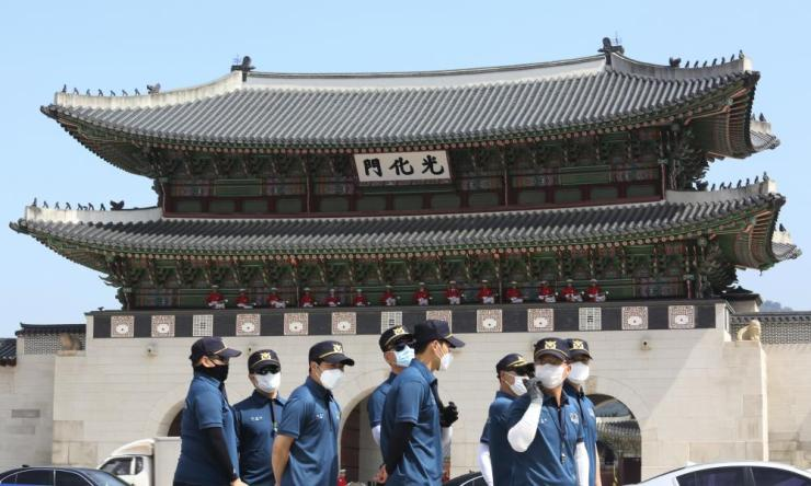South Korean police officers wearing face masks to help protect against the spread of the new coronavirus stand guard during an event to commemorate the upcoming 70th anniversary of the Korean War.