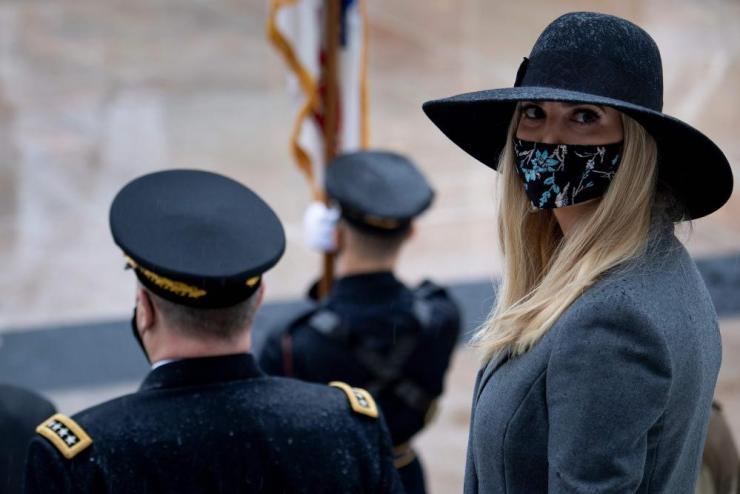 Ivanka Trump waits for a wreath laying ceremony at the Tomb of the Unknown Soldier for Veterans Day at Arlington National Cemetery in one of the few public appearances made by president Trump with his family since his election defeat.