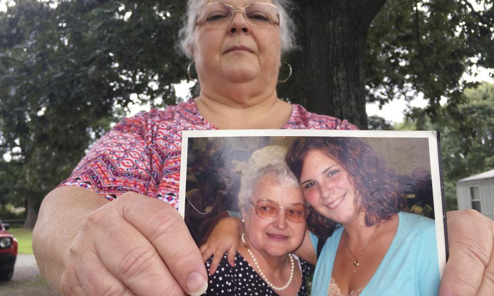 Susan Bro, the mother of Heather Heyer, holds a photo of Bro's mother and her daughter.