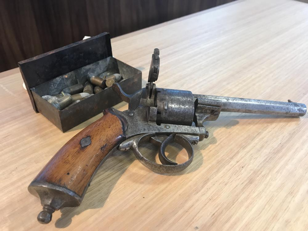 A 150-year-old antique Belgian Lefaucheux 9mm pin-fire revolver and a tin of original rounds handed into Tasmanian police.