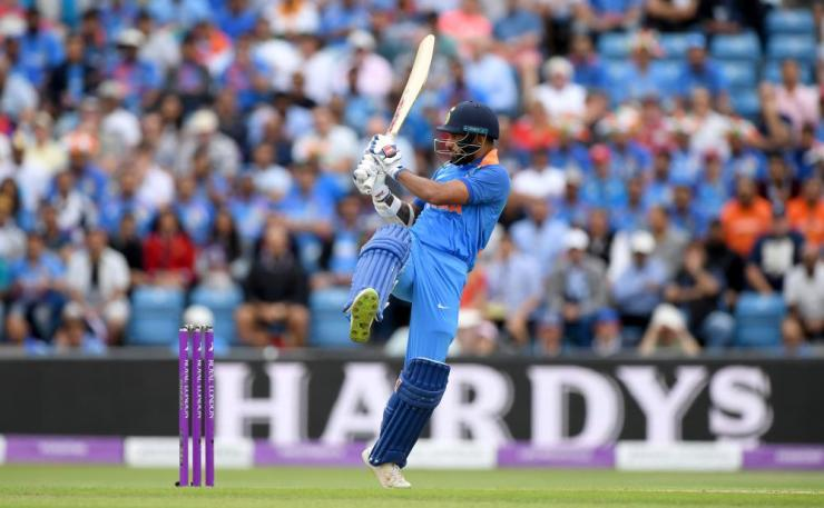 Dhawan smashes Wood for four.