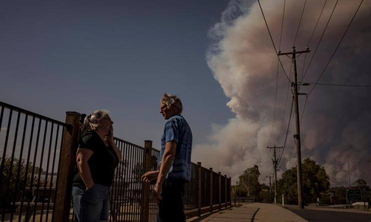 Jenny and Alan Blair watch the fire from the Exchange House B&B in Bairnsdale, Victoria.