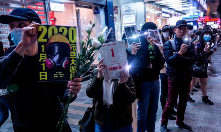 Protesters take part in a human chain rally at the Tsim Sha Tsui district of Hong Kong.