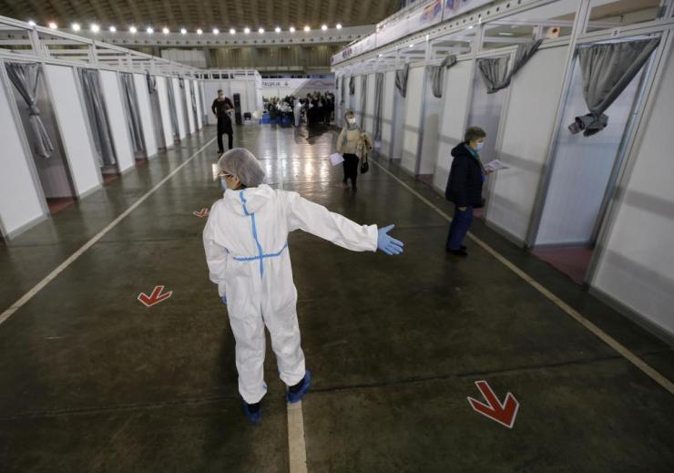 People arrive to receive a dose of Sinopharm Covid-19 vaccine at Belgrade Fair makeshift vaccination center in Belgrade, Serbia, Wednesday, on 17 February, 2021. Serbia, a country of 7 million, has so far vaccinated some 1 million people, mainly with the Chinese Sinopharm vaccine and Russian Sputnik V, and to a lesser extent with the Pfizer jab.
