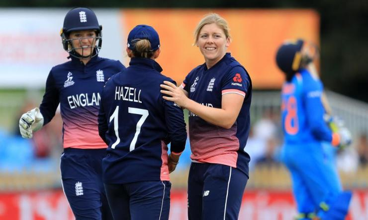 Heather Knight and Danielle Hazell of England celebrate the wicket of Smriti Mandhana of India.