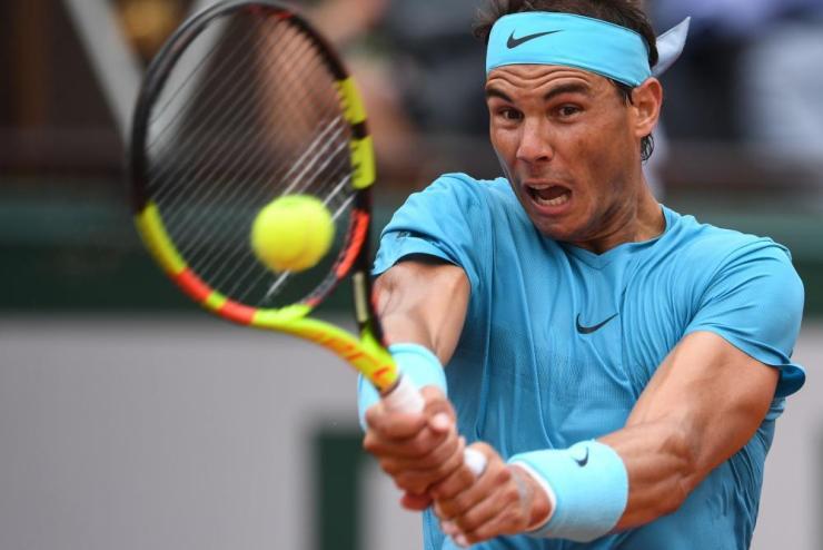 Nadal returns.