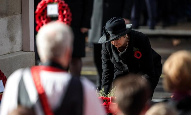 Prime Minister Theresa May lays a wreath