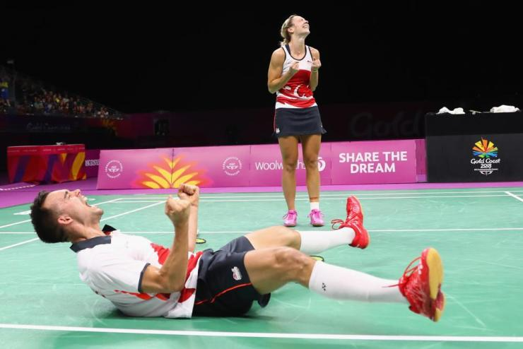 Chris Adcock of England celebrates match point alongside Gabrielle Adcock during the mixed doubles final against Marcus Ellis and Lauren Smith of England during Badminton on day 11 of the Gold Coast 2018 Commonwealth Games.