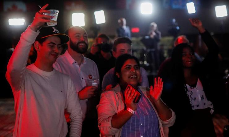 Liberal Party supporters react at initial federal election results at the Palais des Congres in Montreal, Quebec.