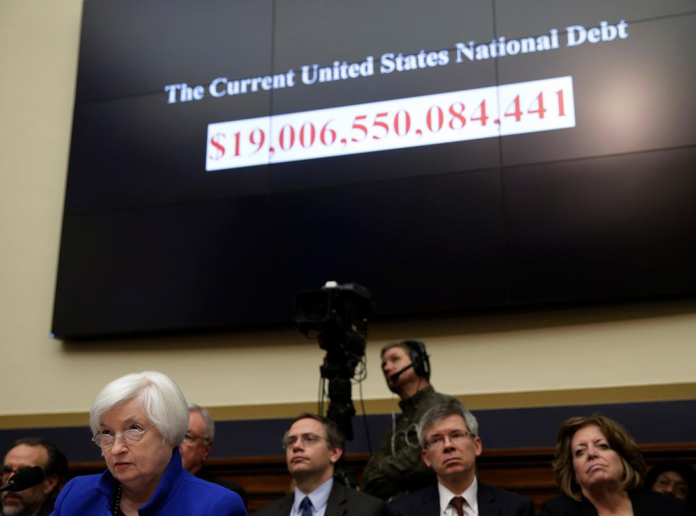 U.S. Federal Reserve Board Chair Yellen testifies in front of the U.S. National Debt amount at the House Financial Services Committee in WashingtonU.S. Federal Reserve Board Chair Janet Yellen (L) testifies at the House Financial Services Committee as the U.S. National Debt amount ticks away in Washington February 10, 2016. REUTERS/Gary Cameron