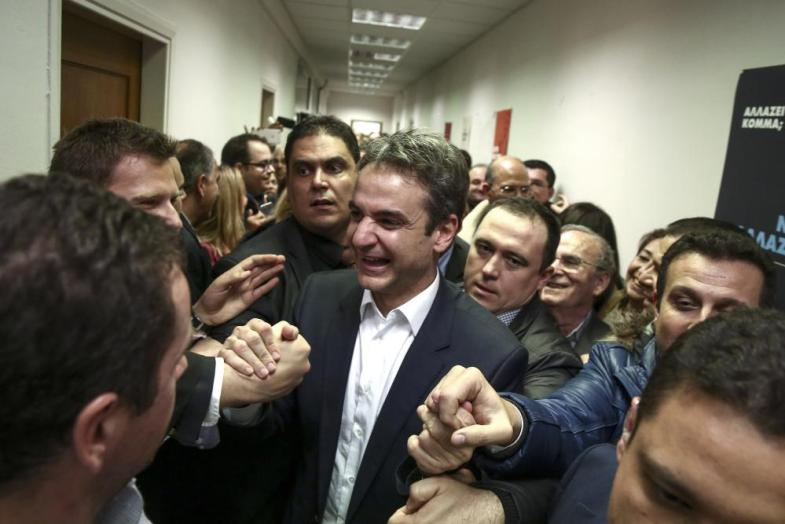 Kyriakos Mitsotakis<br>Newly-elected President of the New Democracy party Kyriakos Mitsotakis, center, is cheered by supporters outside his office in Athens, Monday, Jan. 11, 2016. Greece's conservative opposition New Democracy party has elected the reformist as its new leader. Former administrative reform minister Mitsotakis has defeated party stalwart Evangelos Meimarakis in a leadership contest open to all party members. (AP Photo/Yorgos Karahalis)