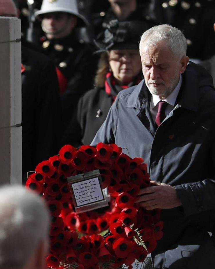 Labour Party leader Jeremy Corbyn lays a wreath