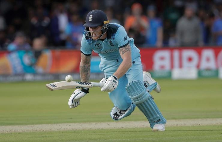 The ball deflects off Ben Stokes' bat as he dives to make his ground during the Cricket World Cup final.