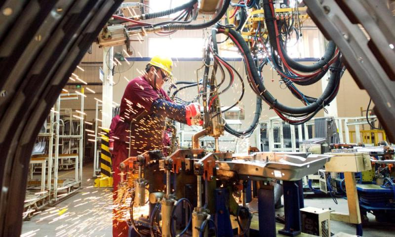 Employee works on the production line at a factory of Chinese automaker JAC Motors in Weifang.