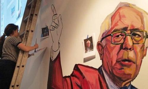 Paige Emery paints a mural of Bernie Sanders