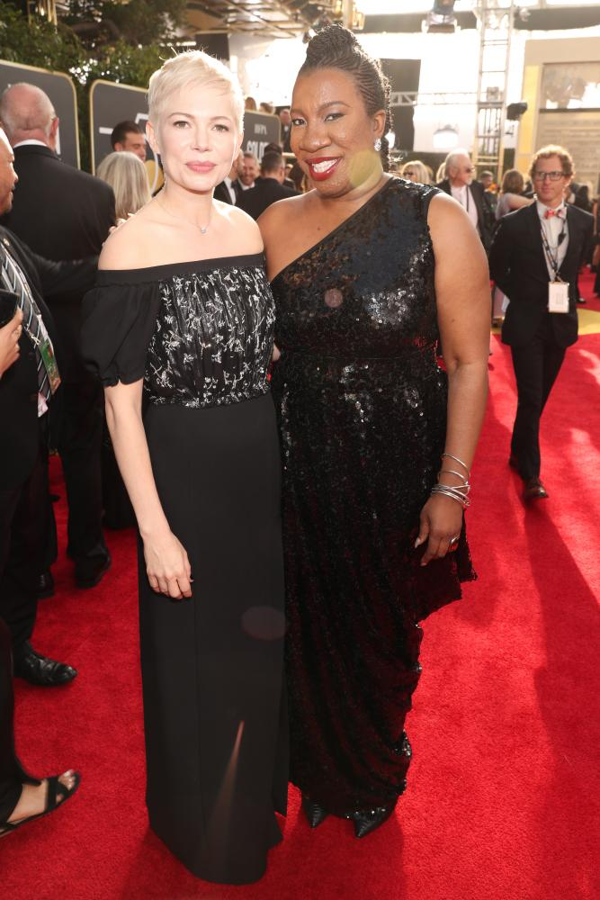 Actor Michelle Williams and activist Tarana Burke arrive to the 75th Annual Golden Globe Awards