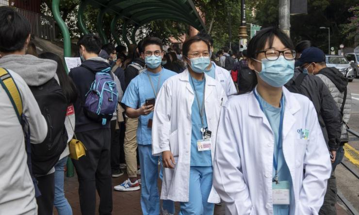 Hundreds of medical workers in Hong Kong participated in a strike in support of the complete closure the border with mainland China.
