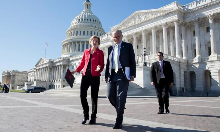 Chuck Schumer with Senator Elizabeth Warren on Capitol Hill. Schumer called the Republican tax plan 'entirely divorced from the real problems'.