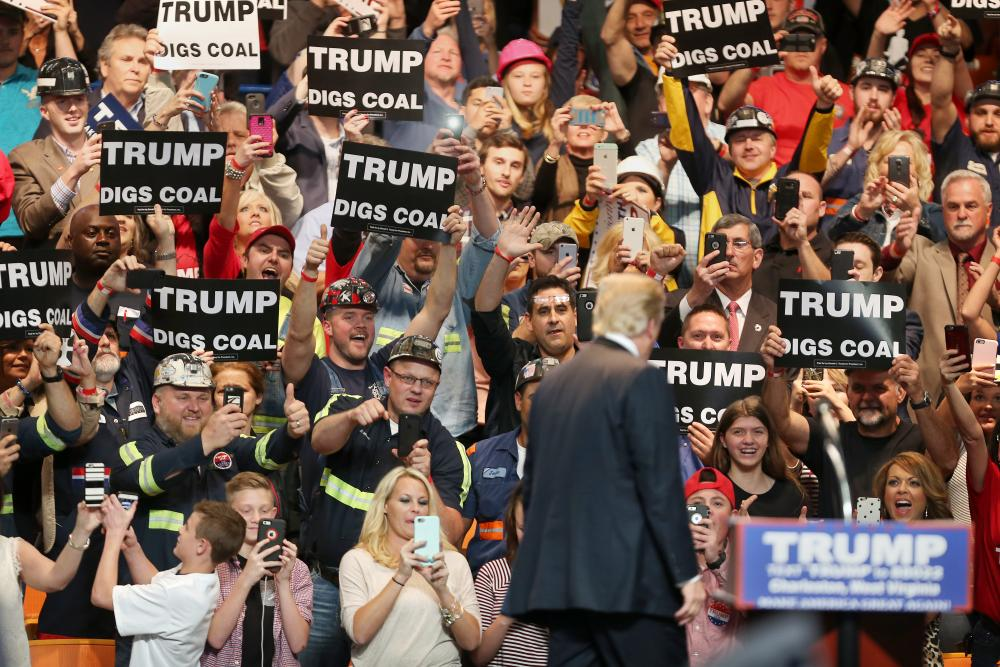 Supporters cheer Donald Trump at a rally in Charleston, West Virginia