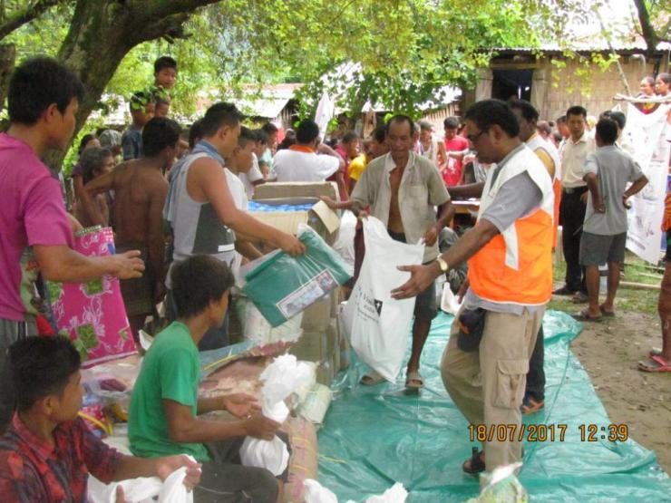 World Vision relief workers distribute emergency kits to Chakma refugee families affected by flooding