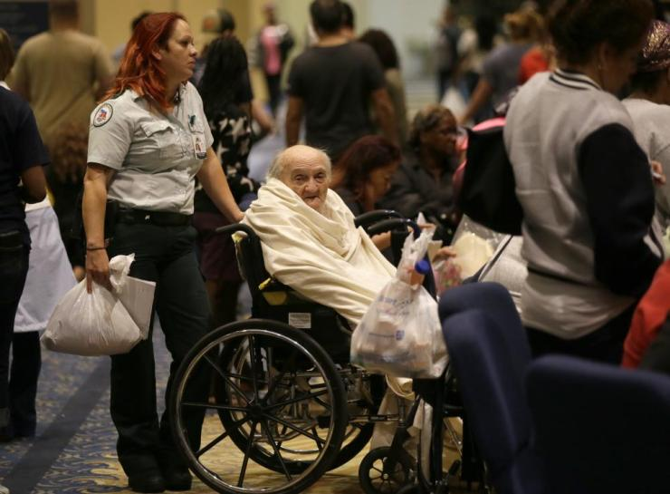 Joel OlsteenEvacuee Teddy Gifford, 90, waits for a medical evaluation with first responder Veronica Garza at the Lakewood Church in Houston, Texas, Tuesday, Aug. 29, 2017. Joel Olsteen and his congregation have set up their church as a shelter for evacuees from the flooding by Tropical Storm Harvey. (AP Photo/LM Otero)