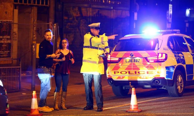 Police stand by a cordoned off street close to the Manchester Arena