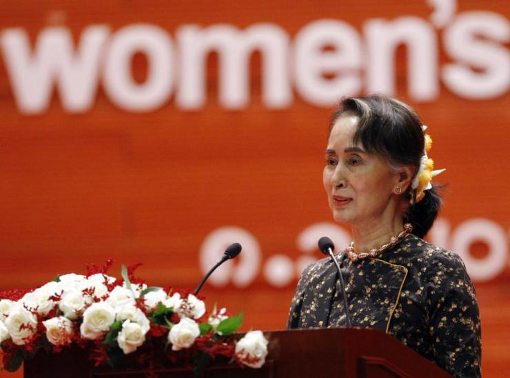 Aung San Suu Kyi delivers a speech during a ceremony to mark International Women's Day at the Myanmar International Convention Centre.