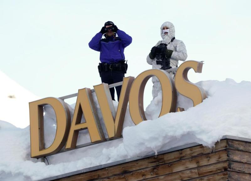 Swiss police officers on the roof of the Davos Congress Hotel this morning.