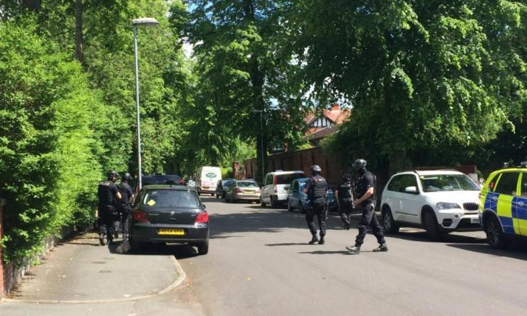 Police raid in Carlton Road.
