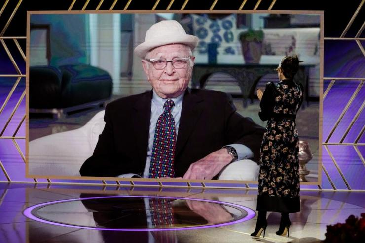 Norman Lear accepts the Carol Burnett award via video while Tina Fey listens.