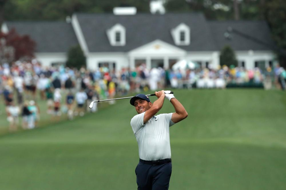 Leader, Molinari hits his second on the first hole.