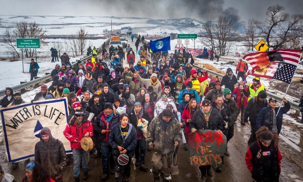 Dakota Access Pipeline water protectors march in South Dakota.