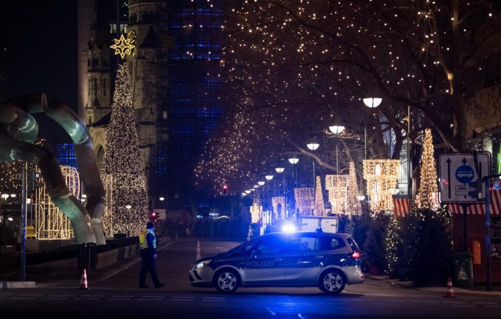 A police vehicle blocks the entrance to Breitscheidplatz and the Kaiser Wilhelm memorial church.